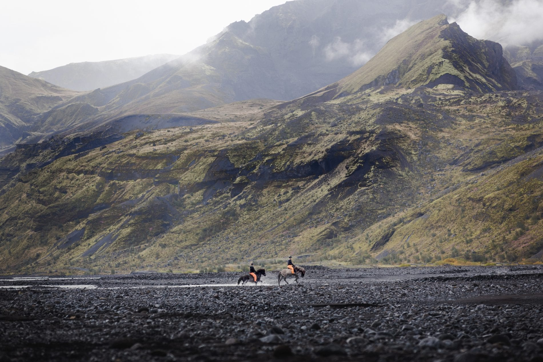 A couple riding in the fascinating landscape of Þórsmörk