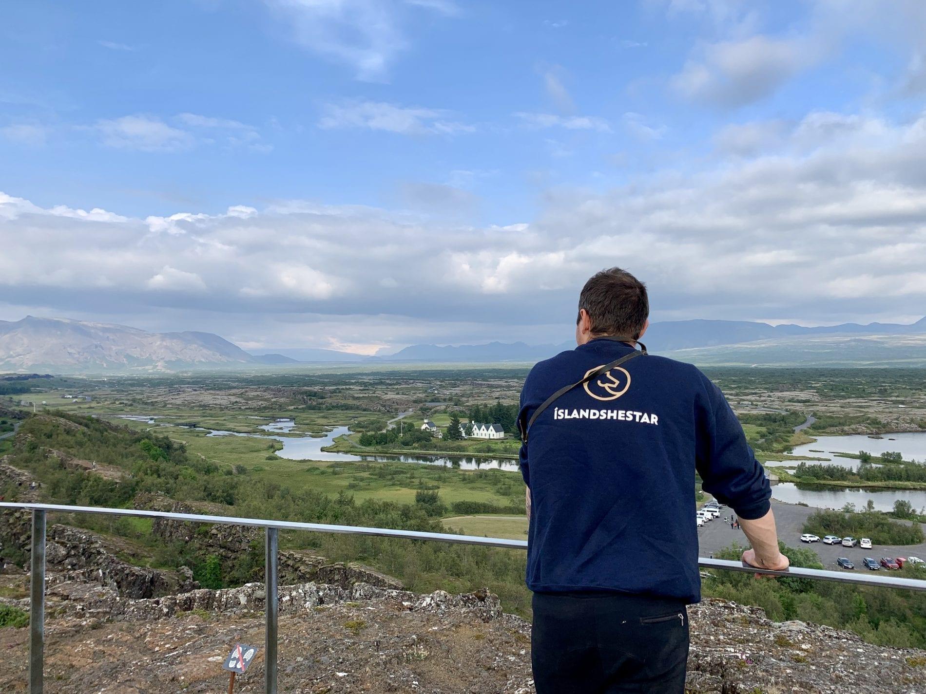 A man from Íslandshestar looks over the geographically and historically famous Þingvellir